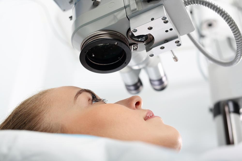LASIK Explained Blog - Woman Under Eye Machine